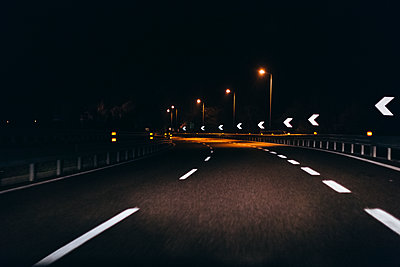 Italy, Udine, driving at night along the highway - p300m1114963f by Mauro Grigollo