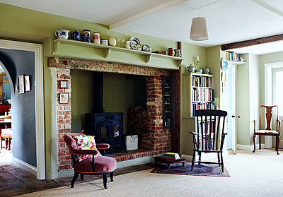 Fireside seating beside Norfolk wood burning stove - p349m790050 by Brent Darby