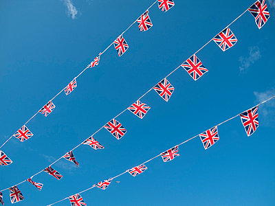 Three strings of Great Britain Union Jack bunting - p1072m829471 by Neville Mountford-Hoare