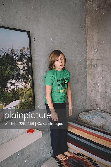Cool Kid Leans against a concrete wall - p1166m2258489 by Cavan Images