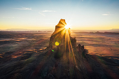 Aerial view of Agathla Peak in the morning from above, Arizona - p1166m2157022 by Cavan Images