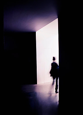 A person on the way out of a room. - p312m672787 by Bruno Ehrs
