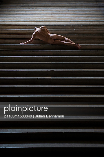 Naked man lying on stairs - p1139m1503040 by Julien Benhamou