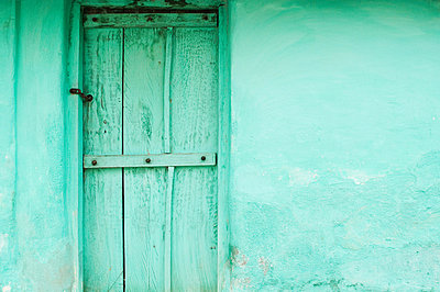 Green wooden door and wall of village house near Mysore, Karnataka - p9242822f by Image Source