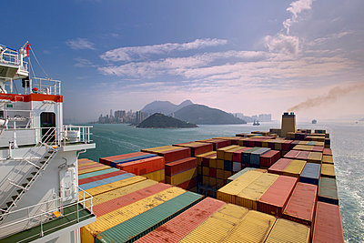 Container ship in front of Hong Kong - p1099m857097 by Sabine Vielmo
