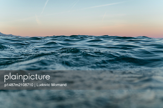 Underwater split shot taken at sunrise - p1487m2108710 by Ludovic Mornand