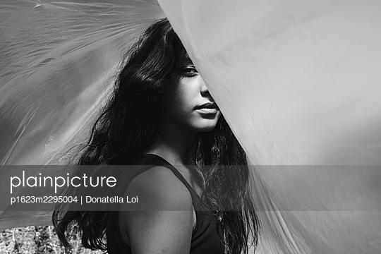 Girl under a plastic foil - p1623m2295004 by Donatella Loi