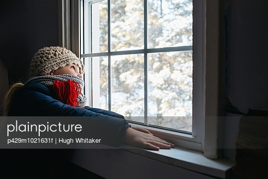 Girl looking out of window - p429m1021631f by Hugh Whitaker