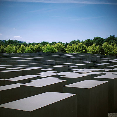 Holocaust memorial with tree line - p1072m993501 by Neville Mountford-Hoare