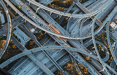 Aerial view of highway interchange in cityscape - p555m1305504 by Chris Sattlberger