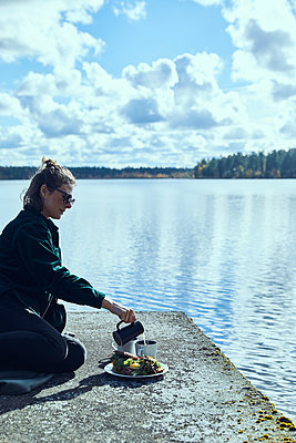 Sweden, Coffee break at the lake - p1573m2244348 by Christian Bendel