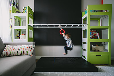 Boy playing in kids room - p1414m1590575 by Dasha Pears