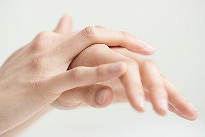 Hands touching skin to skin - p1041m1042346 by Franckaparis