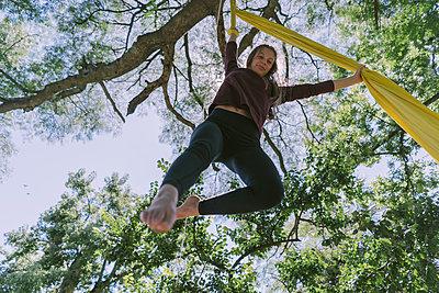 Aerial Silks Performer Hanging On The Trees - p1166m2106801 by Cavan Images