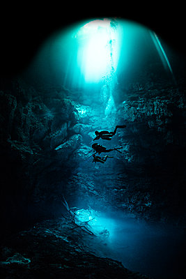 Freediver cavern diving in the pit cavern, Tulum, Quintana Roo, Mexico - p924m2018767 by Ken Kiefer 2