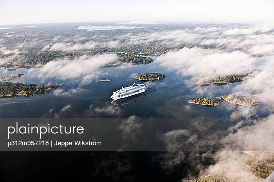 Coast in clouds - p312m957218 by Jeppe Wikström