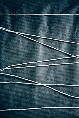 Cord around parcel - p1248m2187194 by miguel sobreira