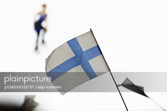 Finnish flag in the air - p1242m2122157 by teijo kurkinen