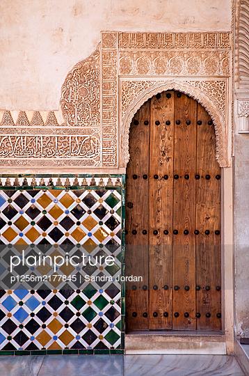 Rustic wooden door, Alhambra, Granada, Spain - p1256m2177845 by Sandra Jordan