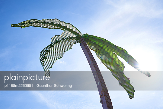 Artificial palm tree in backlight - p1198m2283891 by Guenther Schwering