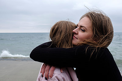 Two sisters are hugging near sea - p1363m2082261 by Valery Skurydin