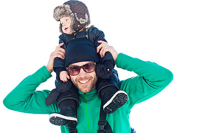 Father with baby son on shoulders - p312m1024541f by Ellinor Hall