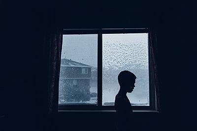 Child in Dark Winter Light - p1262m1087706 by Maryanne Gobble