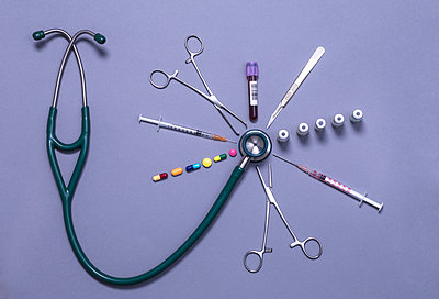 Stethoscope surrounded by an assortment of medical equipment and treatments - p300m2197161 by Andrew Brookes