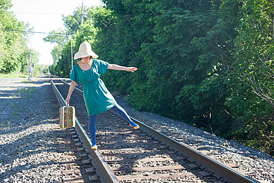 Woman Walking On Railway Track - p463m1066049 by Yo Oura