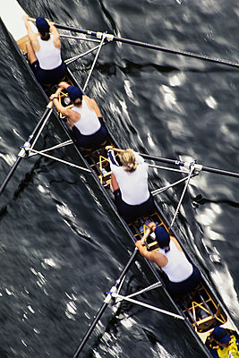 Overhead view of a female rowing crew in their racing shell, rowing boat.  - p1100m1220576 by Mint Images