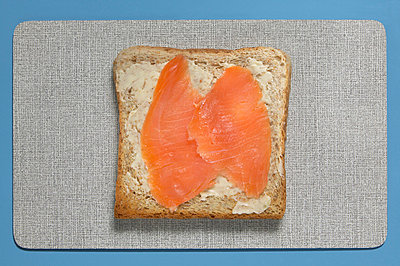 Slice of bread with salmon, elevated view - p3007160f by Tom Hoenig