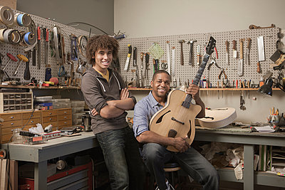 Father and son in music workshop - p555m1480086 by John Fedele