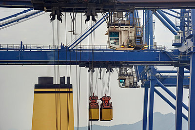 Crane in container terminal - p1099m857107 by Sabine Vielmo