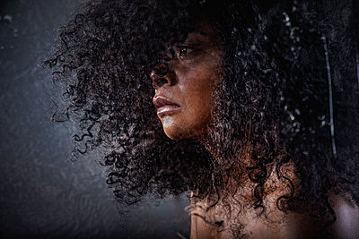 Close up of a black mature woman with texture - p1619m2191643 by Laurent MOULAGER