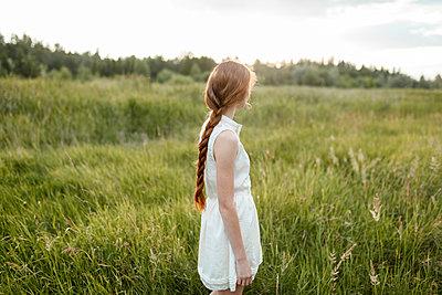 Caucasian girl standing in field - p555m1521403 by Vyacheslav Chistyakov