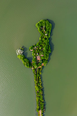 Aerial view of drone of a beautiful small island in the lake - p1596m2185681 by Nikola Spasov
