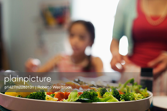 Dish of broccoli and lemon pieces in tomato sauce - p1427m2283131 by Roberto Westbrook