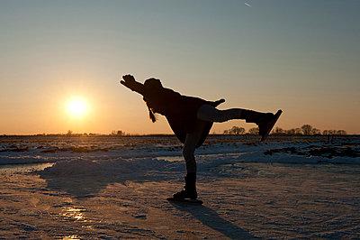Girl ice-skating - p896m835152 by Sabine Joosten