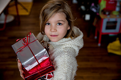 Giving a gift - p1212m1091965 by harry + lidy