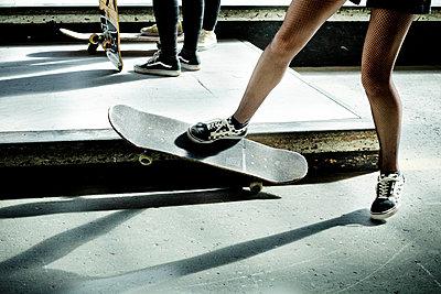 Teen girl in panty hose on a skateboard - p445m2076812 by Marie Docher