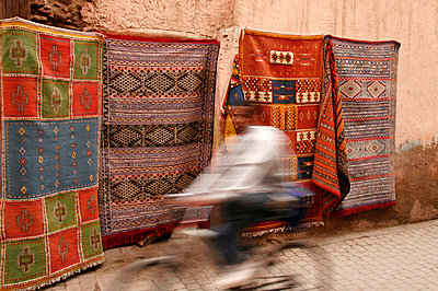Rugs Hanging Outside Building In Medina - p644m728322 by Mark Thomas