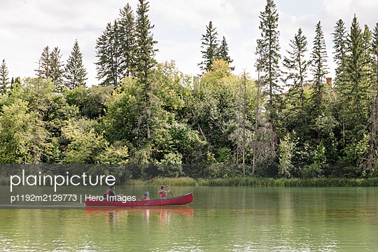Father canoeing with two sons on lake - p1192m2129773 by Hero Images