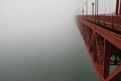 The Golden Gate Bridge Surrounded By Fog, San Francisco - p442m936053 by Gina Easley