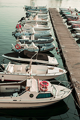 Marina with motorboats  - p947m2119520 by Cristopher Civitillo