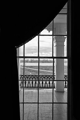 Balcony seen through lattice windows, White Castle, Louisiana - p1686m2288567 by Marius Gebhardt