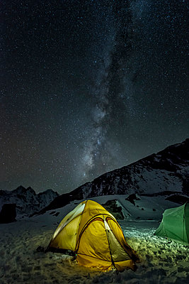 Nepal, Khumbu, Everest region, the milky way and tent from high camp on Pokalde peak at night - p300m1019377f by Alun Richardson