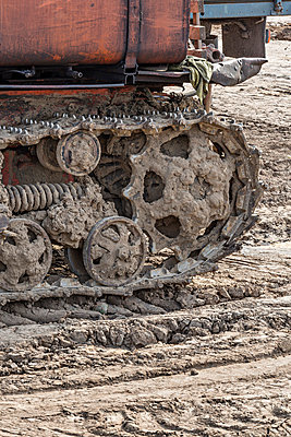 Rusted metal treads on a backhoe - p301m744213f by Vladimir Godnik