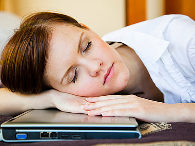 Girl sleeping on computer - p4265240f by Tuomas Marttila
