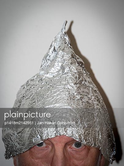Man with a tin foil hat - p1418m2142951 by Jan Håkan Dahlström
