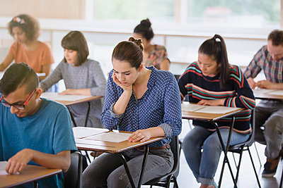 College students taking test at desks in classroom - p1023m1192515 by Sam Edwards